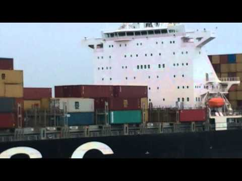 Massive container shipping vessel passing by our Savanahh Ge