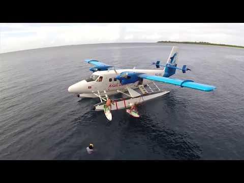 Surfing Four Seasons Kuda Huraa Maldives with Tropicsurf