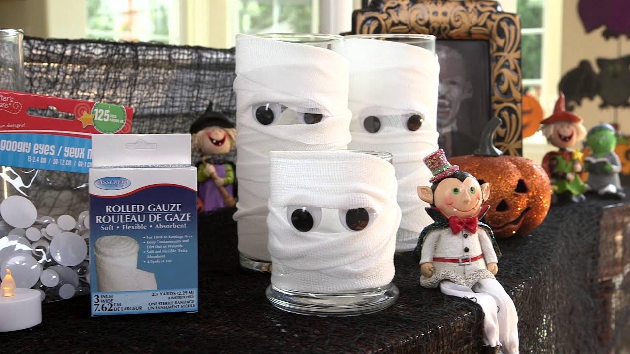 Dollar tree halloween craft idea mumified candles youtube for Craft paper dollar tree