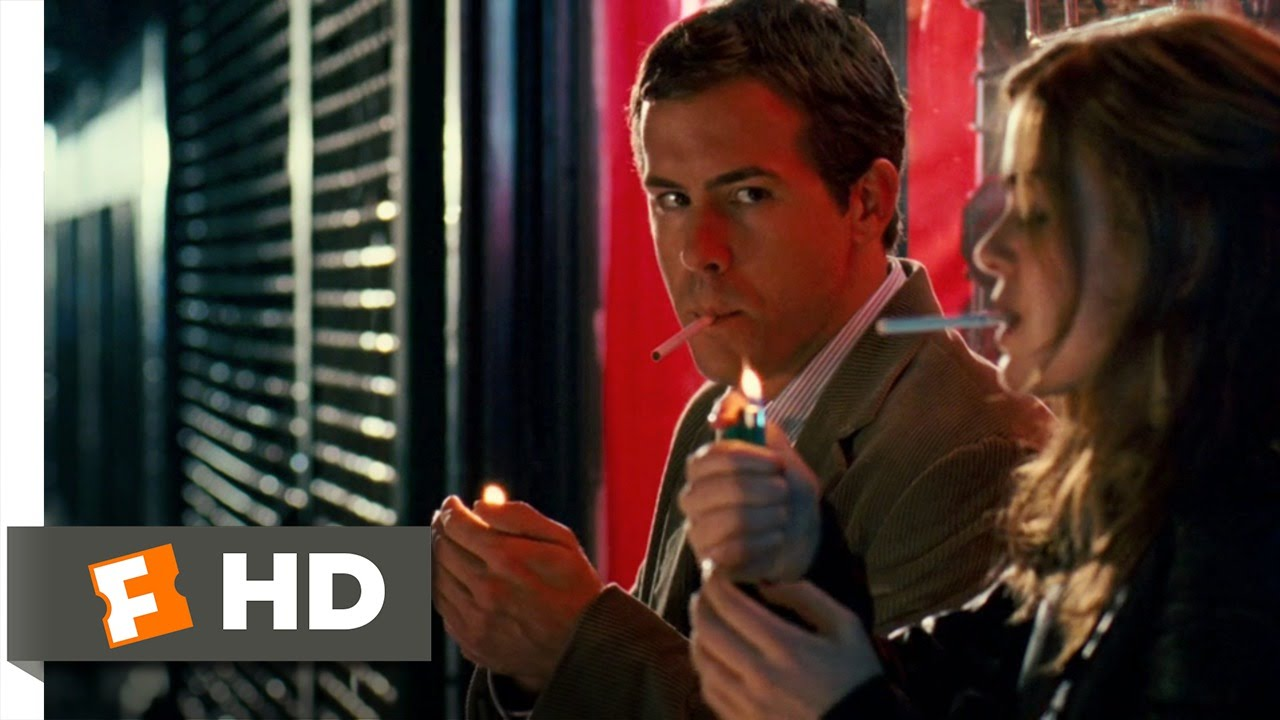 Ryan Reynolds smoking a cigarette (or weed)