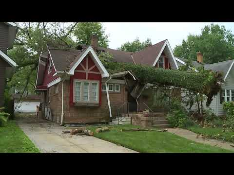 Storm damage causes tree to fall into Cleveland Heights home