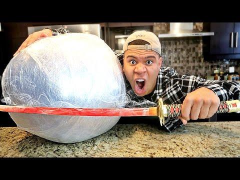 EXPERIMENT Glowing 1000 degree KATANA VS GIANT PLASTIC WRAP BALL! (10,000 LAYERS)