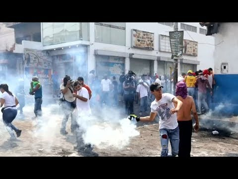 Clashes at Venezuela border escalate as aid stalls on Brazilian side