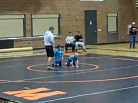 Dylan wrestling in his first match at West Wendover High School