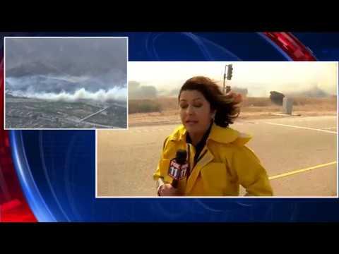 FOX 11 reporter near fast-moving brush fire in Anaheim Hills
