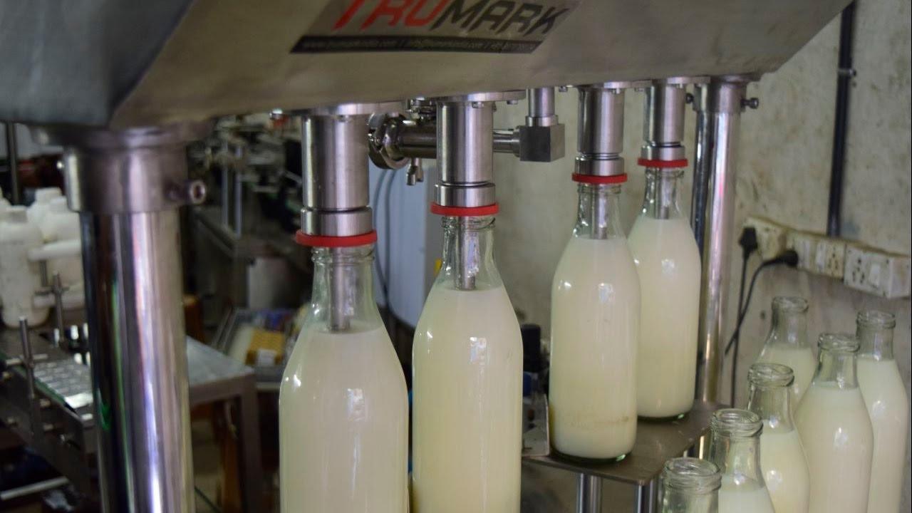 Semi Automatic Gravity Liquid Filler Milk Filling