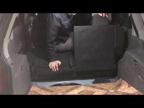 Как сложить задний ряд сидений Mazda Demio DY3W
