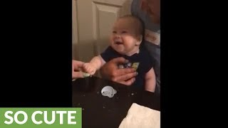 Infant laughs out loud for the first time