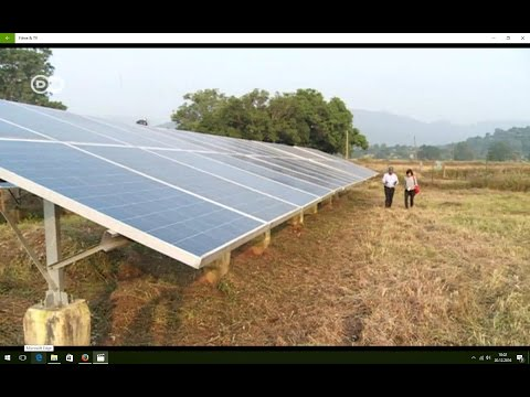 Micro solar power grids in Indian villages, providing clean energy. With English subtitles