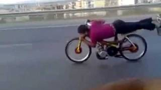 Crazy Guy Planking on  Motorbike Speeding through traffic on highway