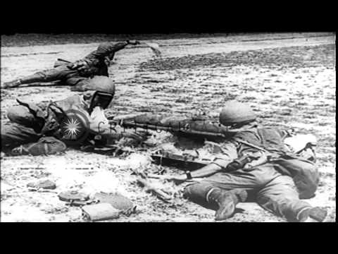 Japanese paratroopers attack Palembang in Dutch East Indies during World War II. HD Stock Footage
