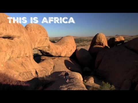 Person walking on rocks in Spitzkoppe, Namibia