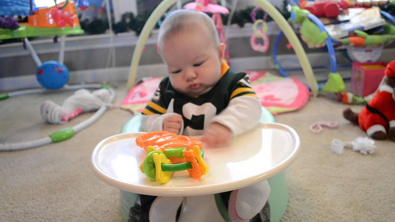 3 months old sitting in her bumbo seat