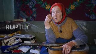 Belarus  'They call me … Guitar!' See 85 yo guitar hero granny play the blues with a LIGHTBULB