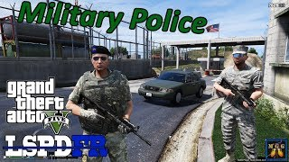 Military Police Patrol In Crown Victoria