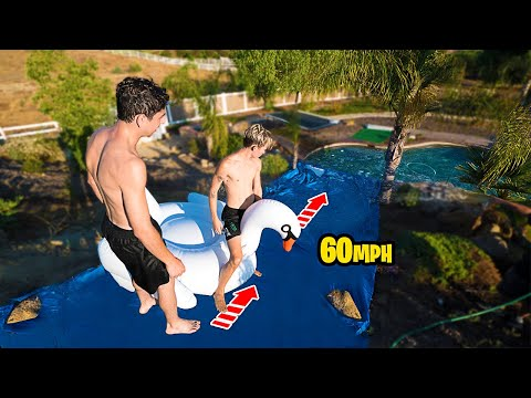 INSANE DIY HOMEMADE 60 MPH WATER SLIDE!! *WORLD RECORD*