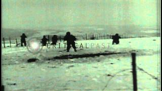 American soldiers firing rifles and machine guns during World War II. HD Stock Footage