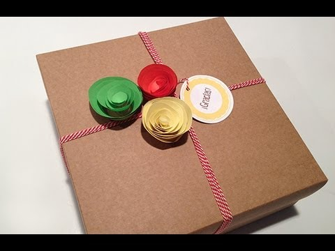 Envolver regalos de forma original con flores de papel - Envolver libros de forma original ...