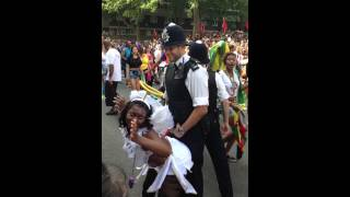 Policeman dancing at Notting Hill Carnival