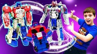 Видео про роботов. Клоны Оптимуса и Бамблби - Трансформеры и Расти Механик в автомастерской