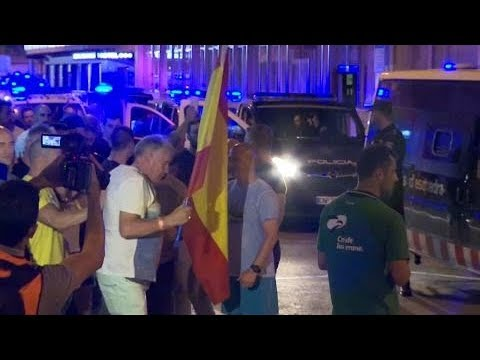 Pro-Spain protesters demonstrate in solidarity with Spanish police