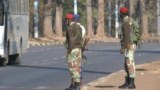 Zimbabwe soldiers enforce protest ban on empty streets of Harare | AFP