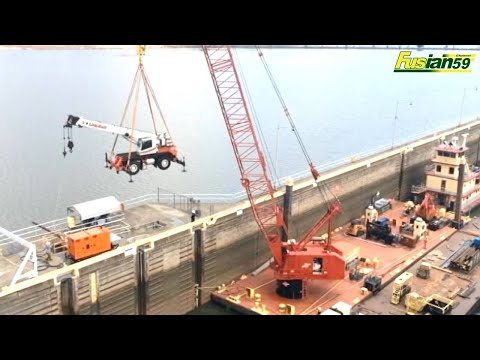 Cranes Lifting Wheeled Mini Cranes From Barges