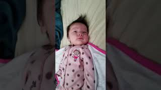 Evelyn waking up 2 months old