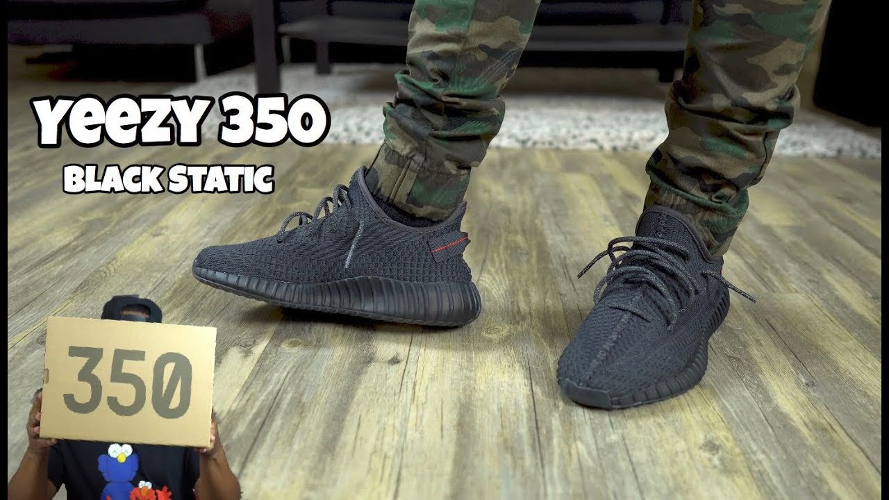 yeezy black static on feet