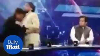 Shocking moment politician brawls with panelist during broadcast