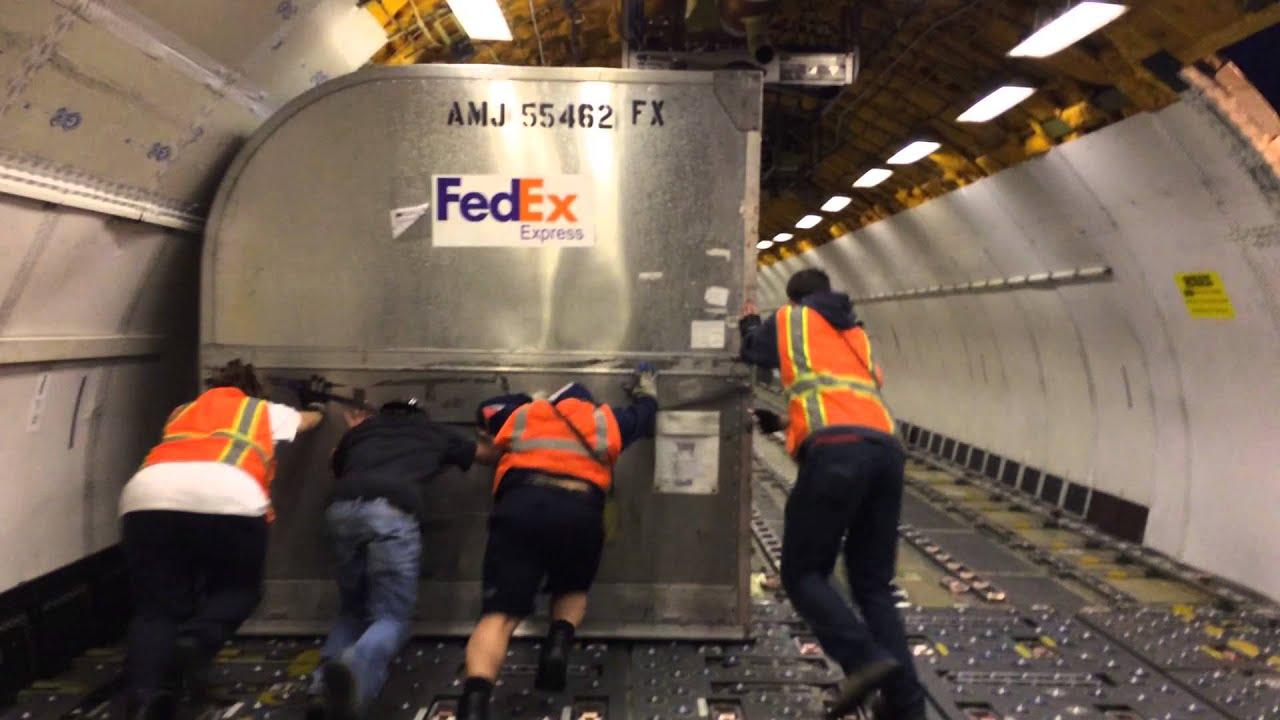 Funny FedEx Cargo Airplane Loading Fail - Trip, Fall and Drag ...