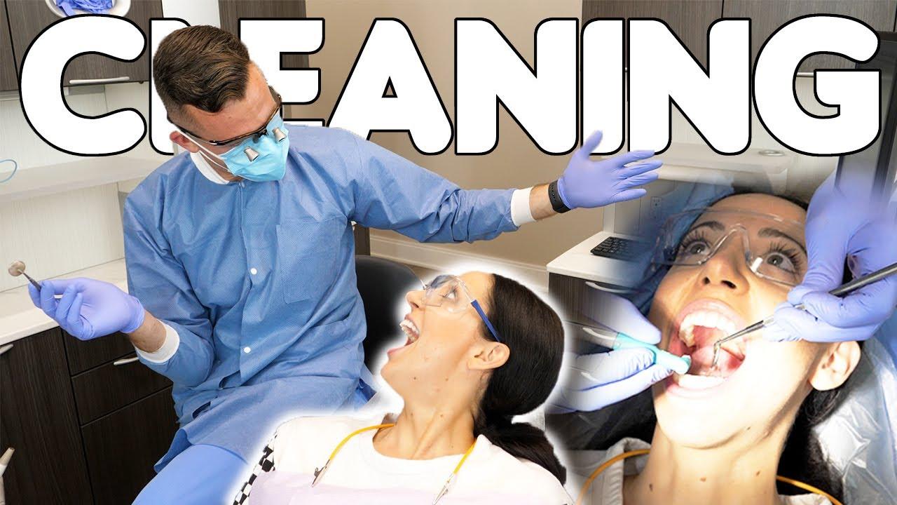 Dentist Cleans Dental Hygienist's Teeth