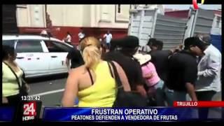 Turba se enfrenta a serenos de Trujillo para evitar desalojo de vendedora ambulante