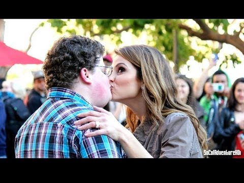 Superbowl Nerd Kisses Extra Host Maria Menounos At The Grove Live! Go Daddy Nerd