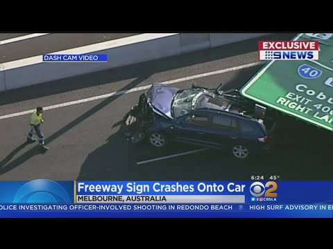 Dave Hill - Sign Falls on Car Driving Down Highway