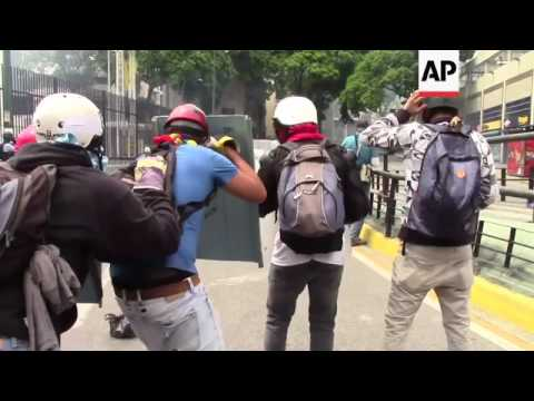 Venezuela opposition protesters are met with gases