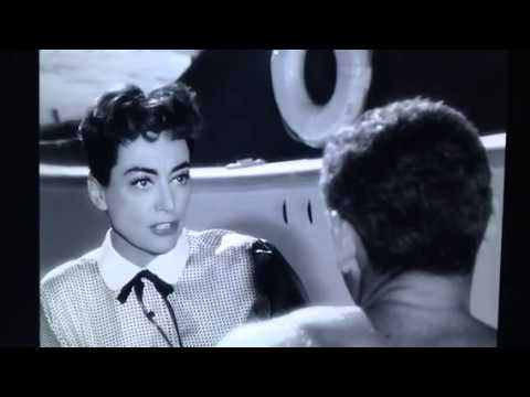 Joan Crawford rejecting Jeff Chandler in FEMALE ON THE BEACH