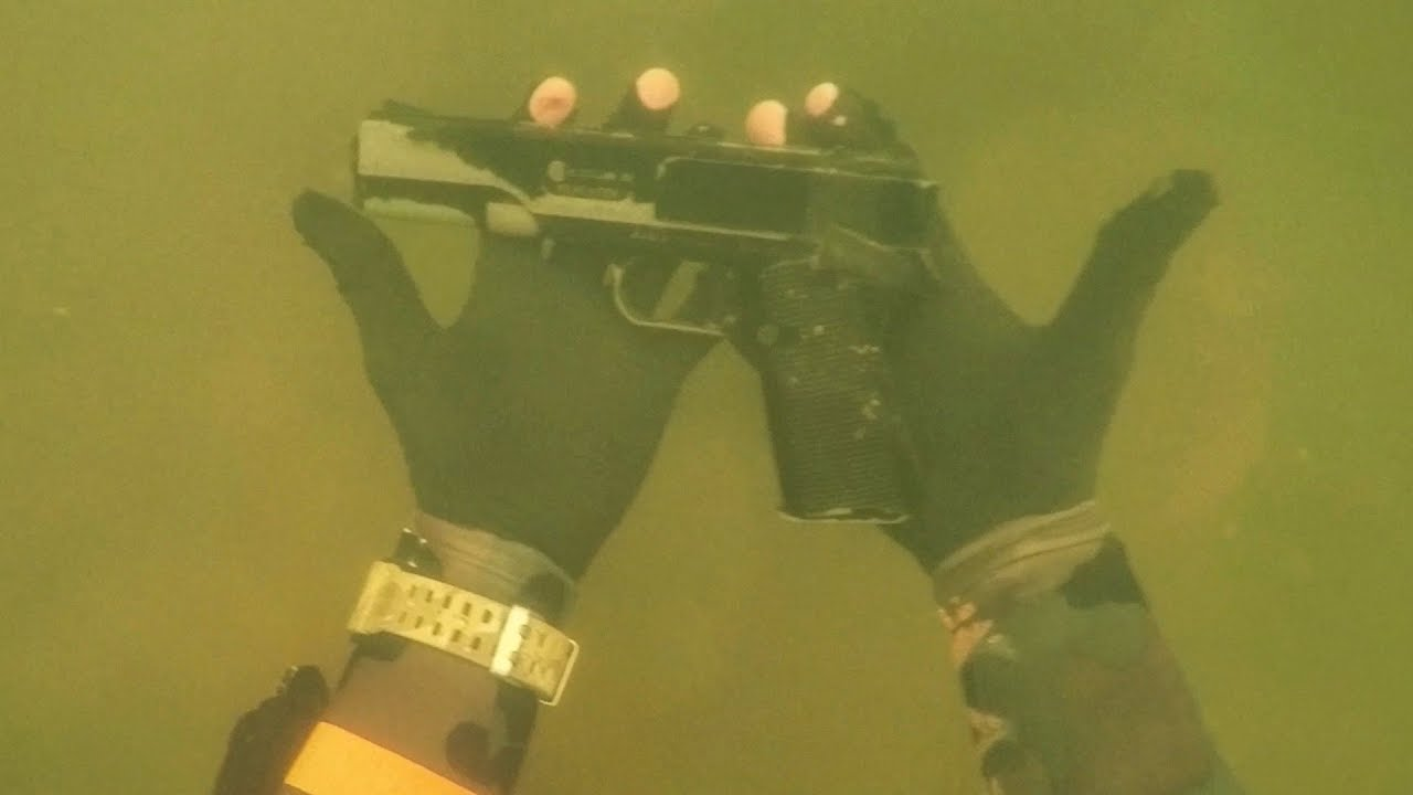 found-gun-underwater-in-river-while-scuba-diving-for-lost-valuables-dangerous-diving-spot