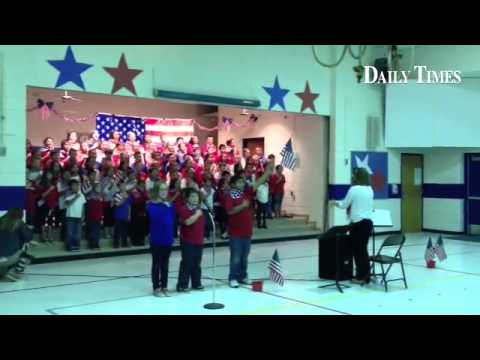 Fourth grade students from Bluffview Elementary School sing the national anthem