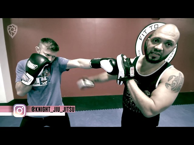 How To Keep Up Defenses While Punching | MMA Coach Buck Grant