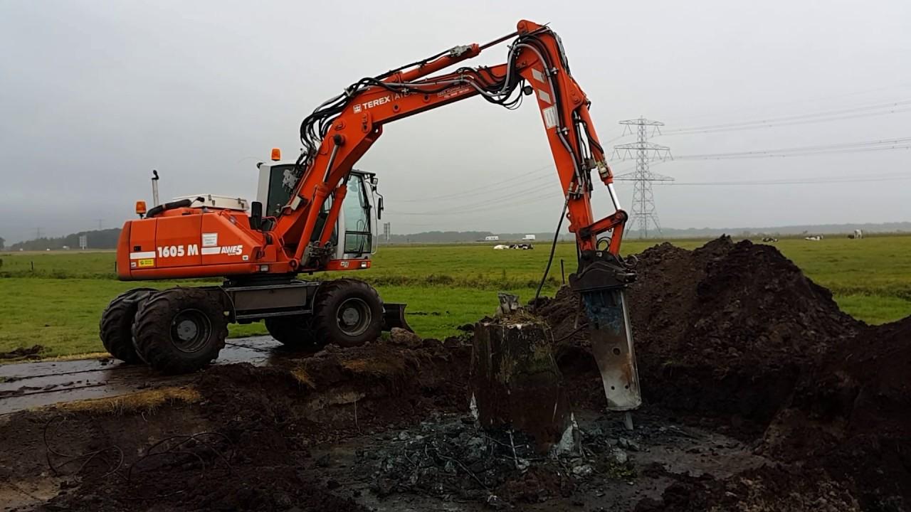 Terex atlas 1605m excavator demolishing electricity for Pylon foundation