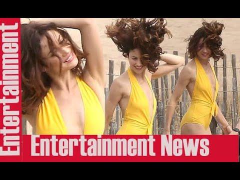 Olga Kurylenko sizzles in a plunging yellow swimsuit  || Scandals