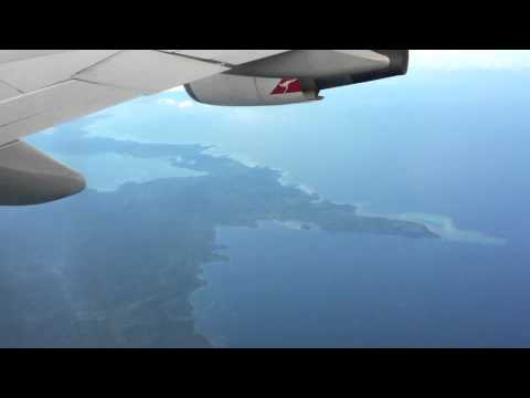 Flying over the Pacific Ocean on a Qantas Boeing 747-400 series Jumbo Jet