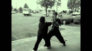 self defense in front of the store Shen Chien School