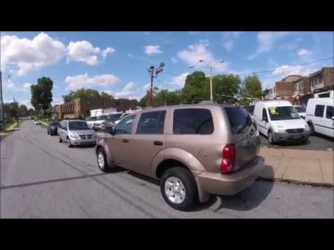 2009 Bronze /Tan Dodge Durango SE 4WD (1D8HB38P39F) with an 4.7L V8 SOHC 16V FFV engine, 5-Speed Automatic transmission, located at 577 Chester Pike, Prospect Park, PA, 19076, (610) 237-1015, 39.886154, -75.302338 - Photo #0
