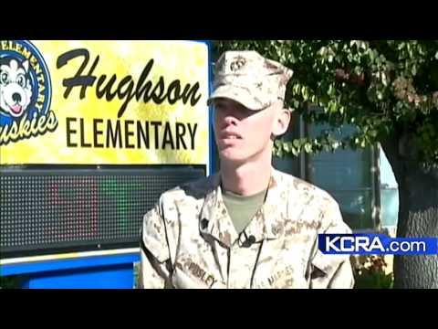 Hughson Marine stands watch over school