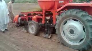 System of Rice Intensification: SRI Transplanting Machine in Pakistan on Demonstration Farm