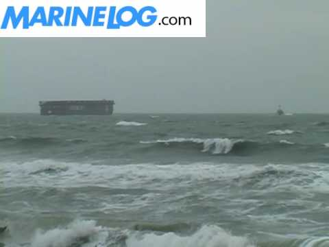 Salvage crews free grounded barge