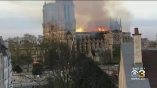 People In Streets Singing Songs Of Prayer Outside Notre Dame Cathedral During Fire