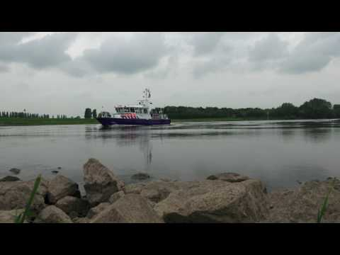 Boats passing by Dutch River (IJssel) Free to Use Stock Footage (no sound)